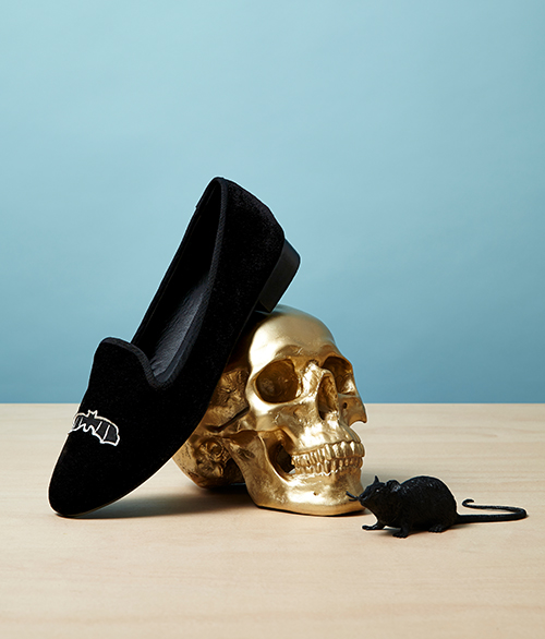 Art direction for Asos Halloween campaign. Bat suede slipper shoe resting on gold skull