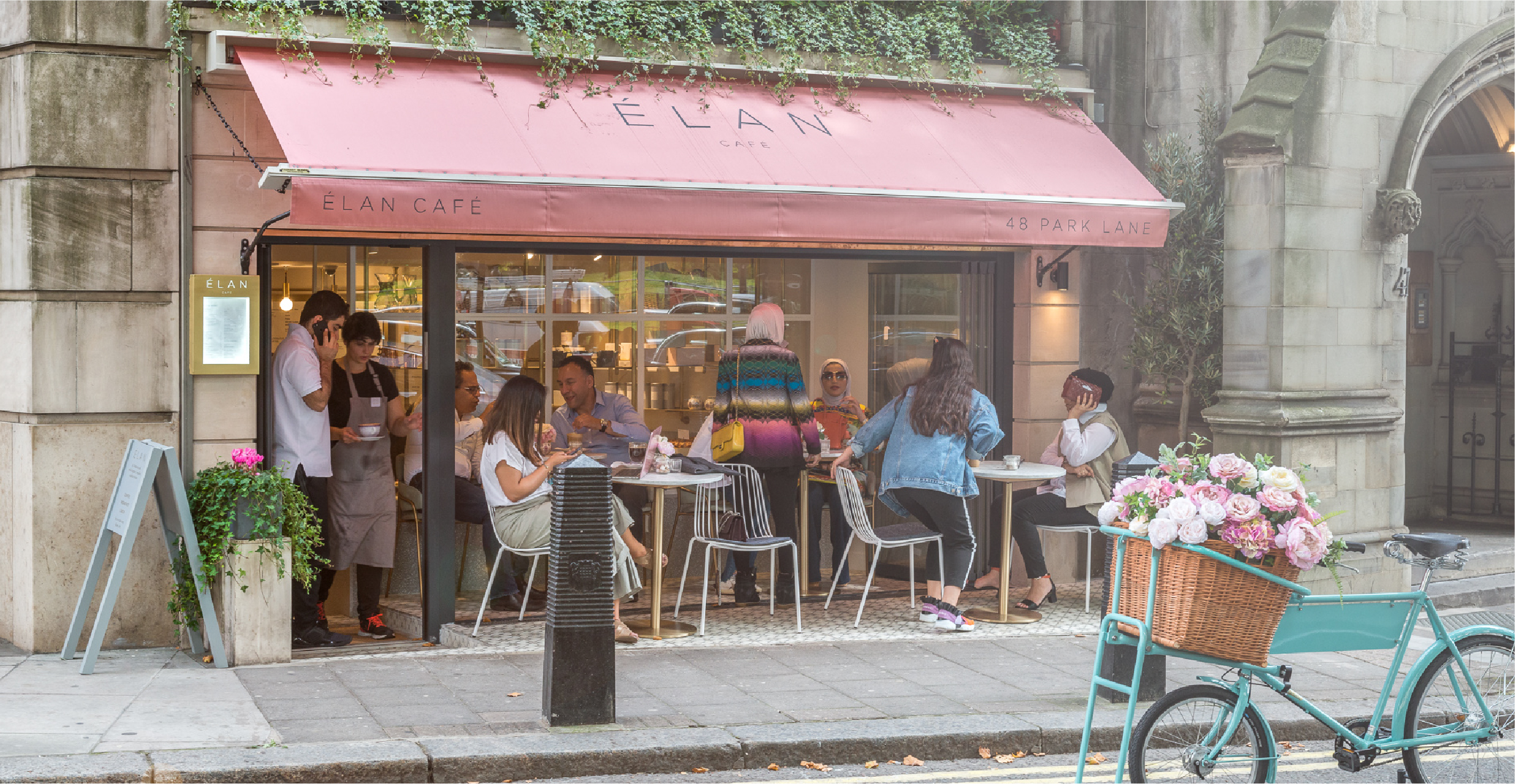 Shot of the outside of Elan on a busy day in Mayfair