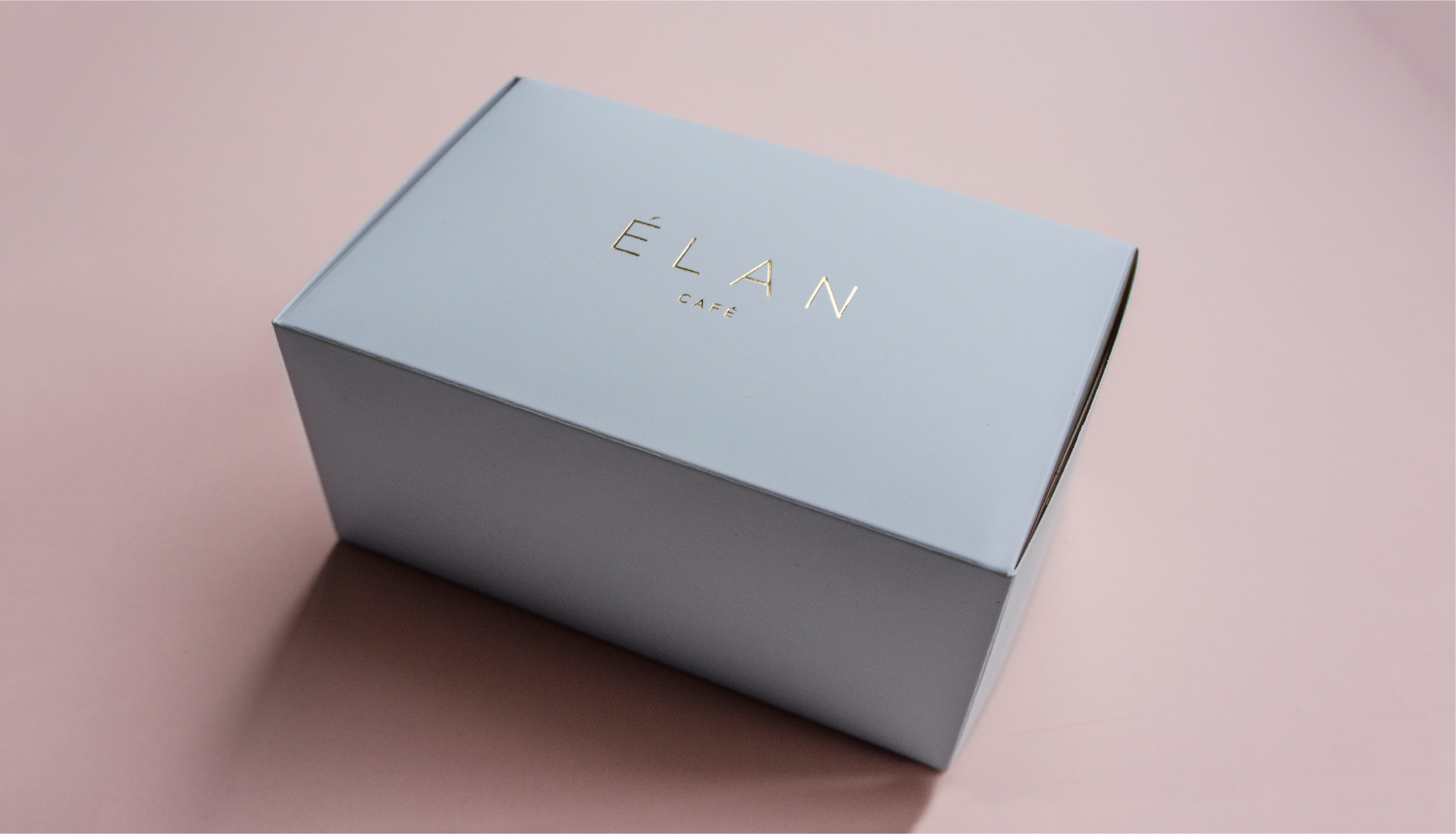 Branding and packaging for cake box for Elan Café