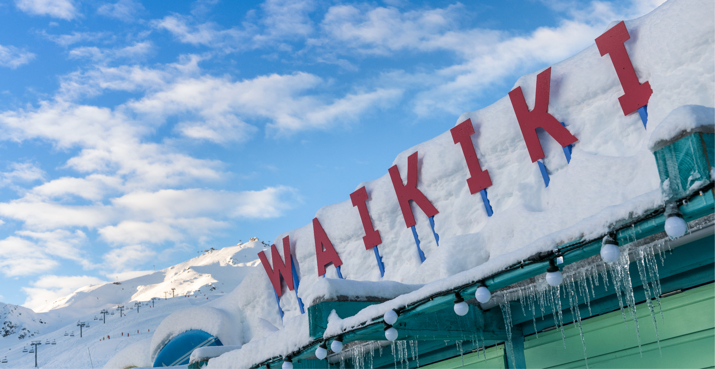 Waikiki Courchevel 1850 branding signage in the snow