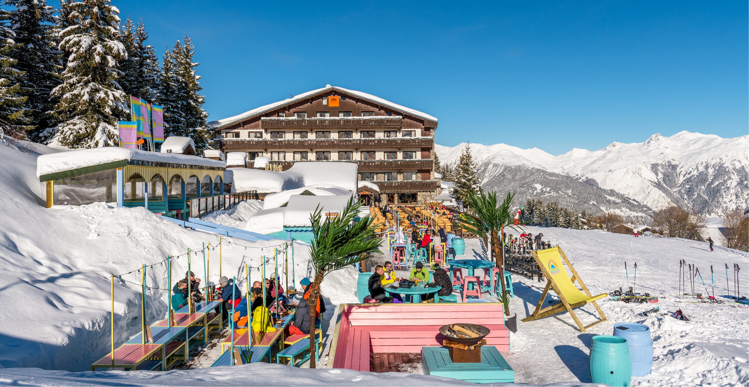 Wide view of Waikiki Courchevel with Hotel Courcheneige in the background