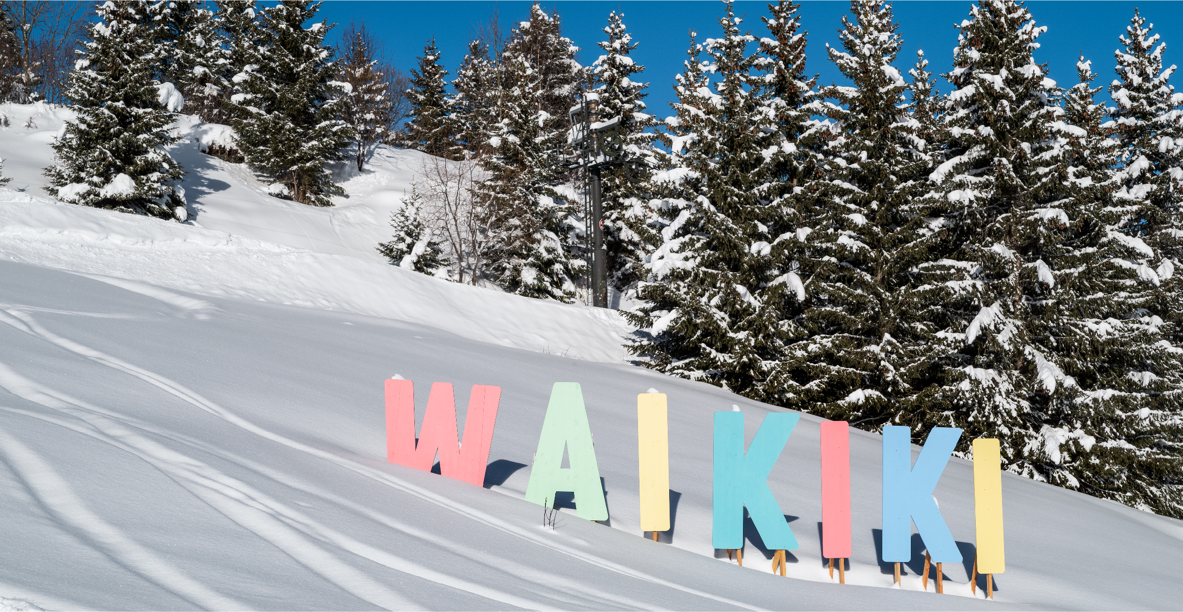 Waikiki take on Hollywood sign. Pastel plywood letters getting buried in the snow